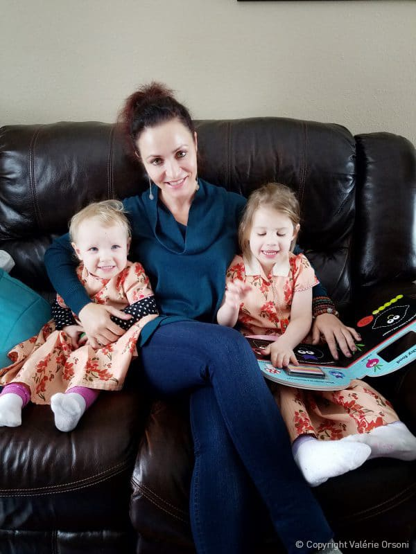Valerie Orsoni reading with Hutterite children