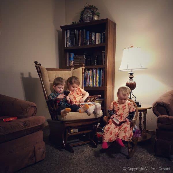 Hutterite children reading at home