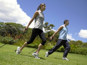 Side profile of a young couple exercising