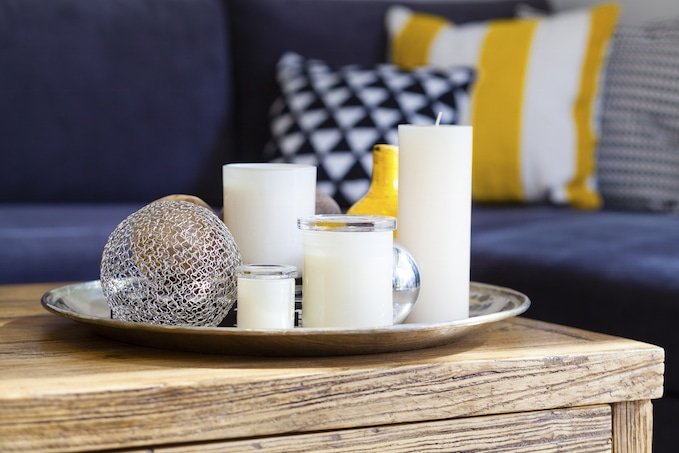 Candle mix on rustic coffee table