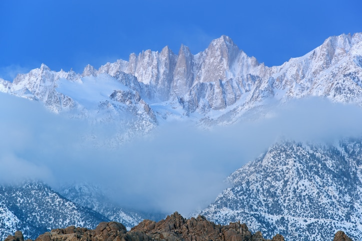 Winter landscape of Mt. Whitney, at dawn with fog, Eastern Sierra Nevada Mountains, California, USA