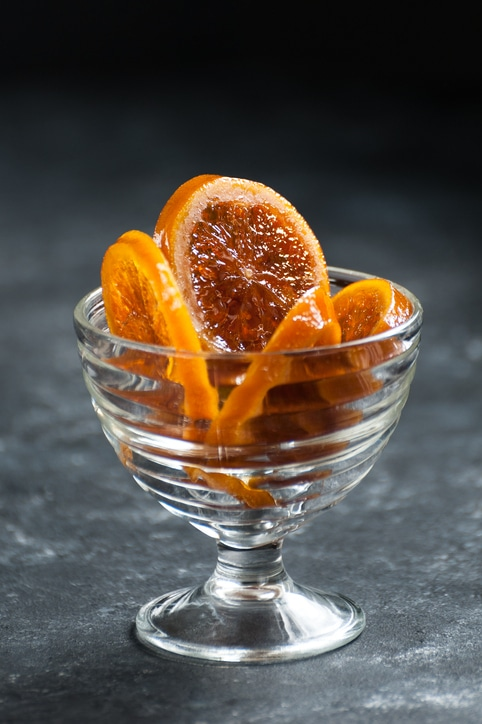 Caramelized oranges in a delicate glass crockery.